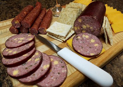 Sausage and snack sticks with cheese and crackers
